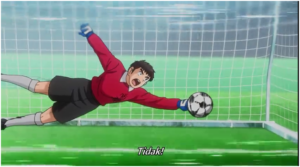 Morisaki berhasil meninju bola